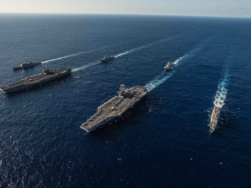 The Ronald Reagan Carrier Strike Group and John C. Stennis Carrier Strike Group sailed the Philippine Sea on Nov. 16 during dual carrier operations. (Navy)