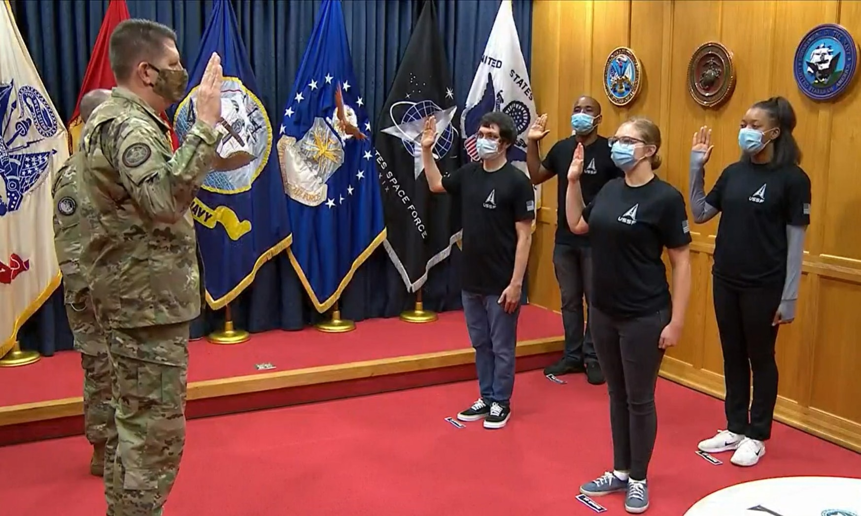 Vice Chief of Space Operations Gen. David Thompson swears in the first four enlisted recruits to the Space Force at Military Entrance Processing Station-Baltimore in Maryland on Oct. 20, 2020. (Screenshot from a U.S. Defense Department livestream)