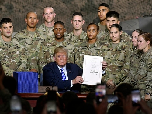 President Donald Trump signs the John McCain National Defense Authorization Act for the Fiscal Year 2019, during a signing ceremony Monday, Aug. 13, 2018, in Fort Drum, N.Y. (Hans Pennink/AP)