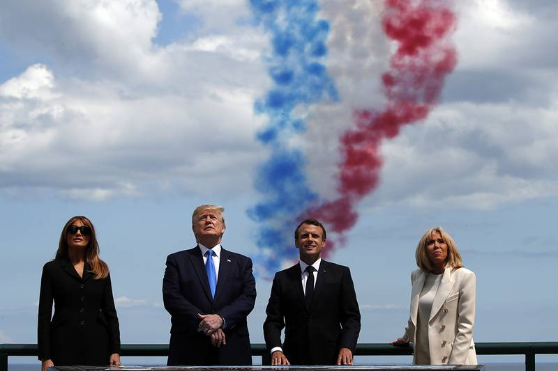 First lady Melania Trump, President Donald Trump, French President Emmanuel Macron and Brigitte Macron, watch a flyover during a ceremony to commemorate the 75th anniversary of D-Day at the American Normandy cemetery