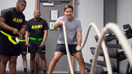 Secretary of the Army Mark Esper conducts PT with soldiers during a recent visit to Fort Drum, New York. Per his order, the soldiers observing him will no longer have to wear reflective belts in the gym. (Daniel Torok/Army)