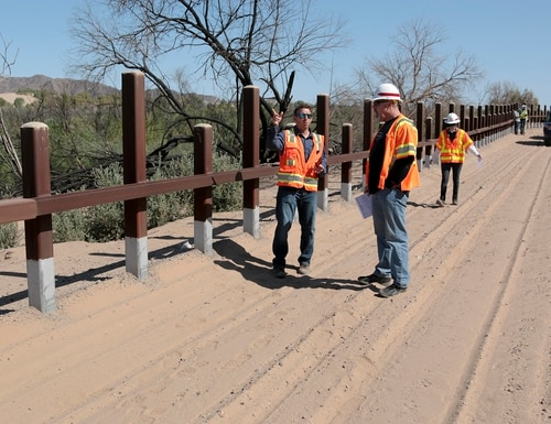 A team from the U.S. Army Corps of Engineers and contractors discuss Customs and Border Protection pedestrian border wall fencing requirements outside Yuma, Ariz., on April 11, 2019. (Army Corps of Engineers)