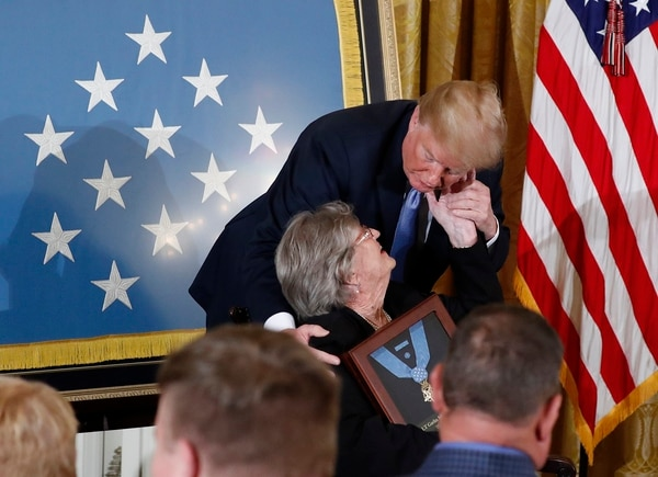 President Donald Trump awards the Medal of Honor to 1st Lt. Garlin Conner. Conner's widow, Pauline, accepts the posthumous recognition, during a ceremony in the East Room of the White House June 26, 2018. Conner is being recognized for actions on Jan. 24, 1945, when he left a position of relative safety for a better position to direct artillery fire onto the assaulting enemy infantry and armor. Conner remained in an exposed position for three hours, despite German forces coming within five yards of his position and friendly artillery shells exploding around him. (Pablo Martinez Monsivais/AP)