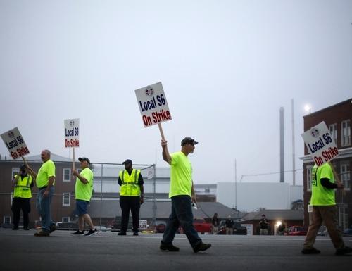 Shipbuilders picket outside an entrance to Bath Iron Works on June 22, 2020, in Bath, Maine. (Robert F. Bukaty/AP)