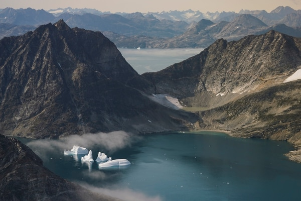 Icebergs are photographed from the window of an airplane carrying NASA scientists as they fly on a mission to track melting ice in eastern Greenland. (Mstyslav Chernov/AP)