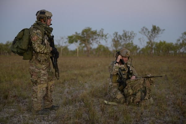 A special tactics combat controller and special tactics officer get ready for a personnel recovery mission after a high-altitude, low-opening parachute jump in Australia's Northern Territory in July 2015. (Senior Airman Stephen Eigel/Air Force)