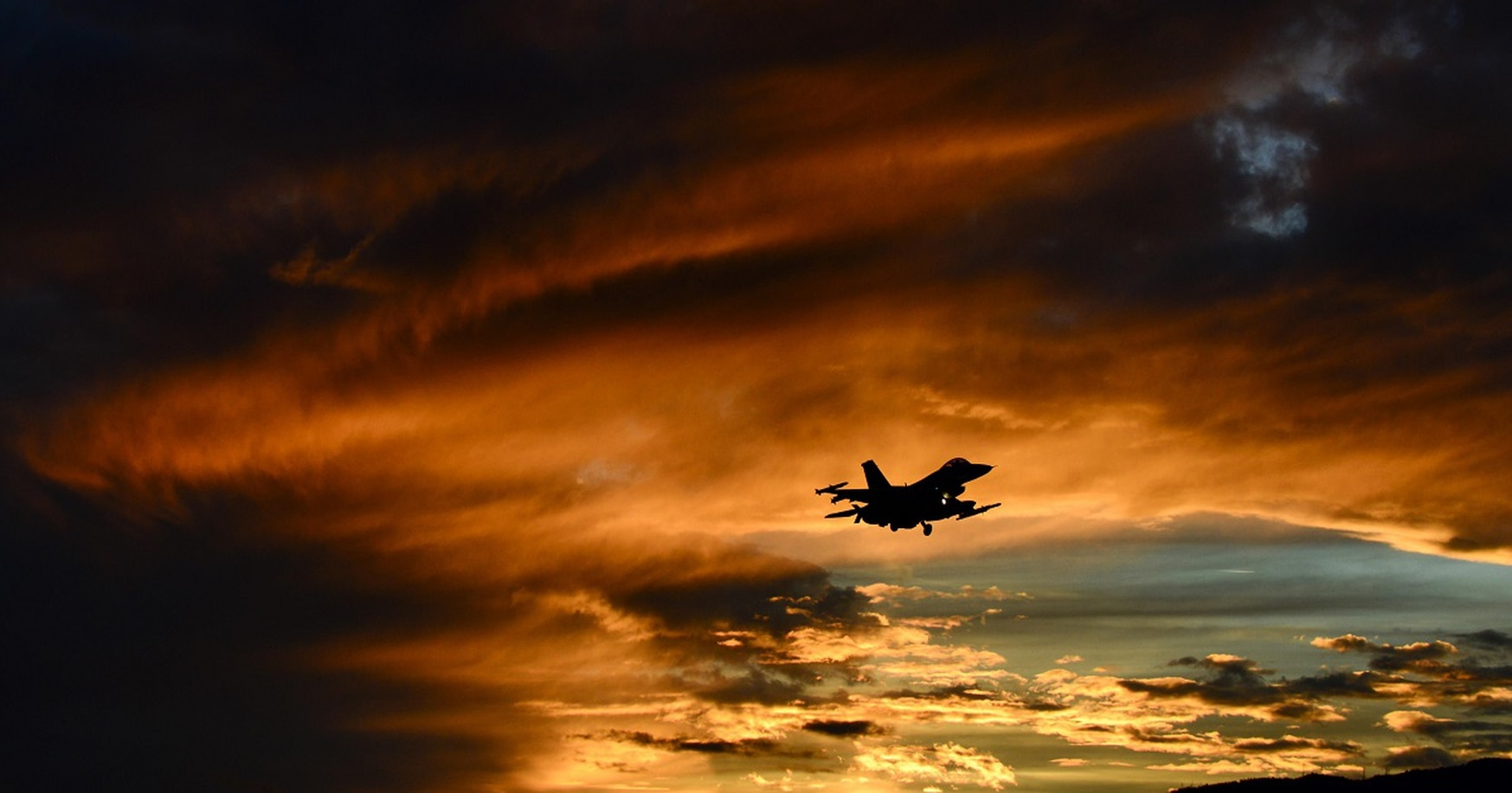 An F-16 Fighting Falcon the 555th Fighter Squadron flies at sunset. The Triple Nickel's deployment to Al Udeid Air Base in Qatar sends a message to Iran. (Staff Sgt. Krystal Ardrey/Air Force)
