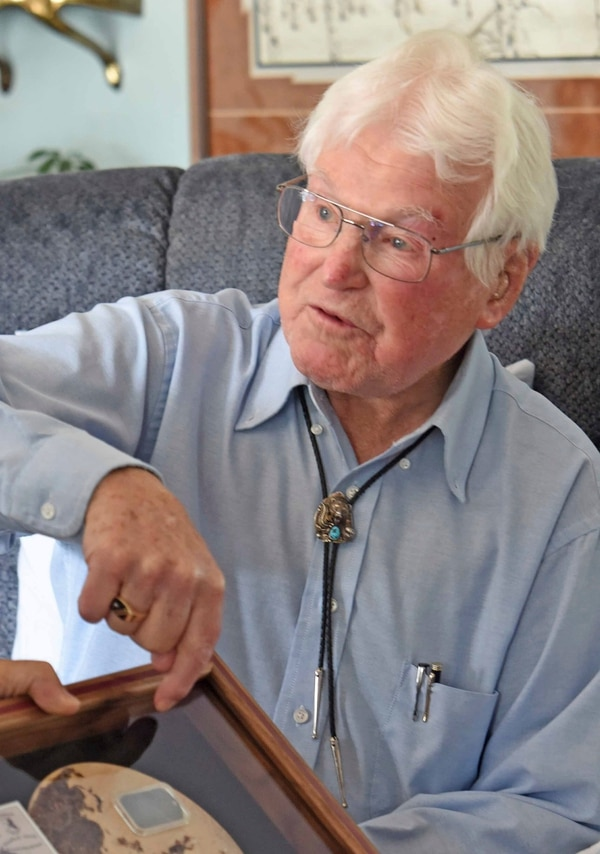 Edwin Boger, 97, a veteran of World War II, shows his Army dog tag that was recently returned to him after it was found in New Guinea. (Tom Stromme/The Bismarck Tribune via AP)