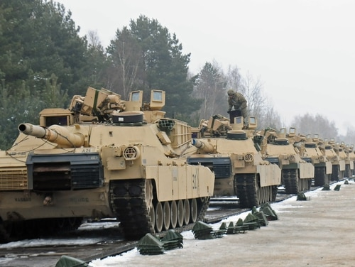 M1A2 Abrams tanks belonging to 4th Infantry Division are loaded onto a flatcar railway in Poland on Jan. 25, 2017. (Staff Sgt. Corinna Baltos/Army)