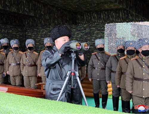 In this Feb. 28, 2020, file photo, North Korean leader Kim Jong Un, center, inspects the military drill of units of the Korean People's Army, with soldiers shown wearing face masks. (Korean Central News Agency/Korea News Service via AP, File)