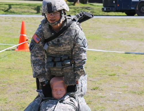 1st Sgt. Heather Buxton drags an 180-pound dummy during a stress shoot April 18 at Joint Base Lewis-McChord, Wash. (Sgt. 1st Class Miriam Espinoza/Army)