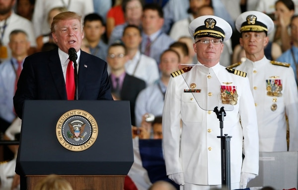 President Donald Trump, left, puts the USS Gerald Ford into commission as Ships commander Capt. Richard McCormack, front right, listens aboard the nuclear aircraft carrier USS Gerald R. Ford for it's commissioning at Naval Station Norfolk in Norfolk, Va., Saturday, July 22, 2017. (Steve Helber/AP)