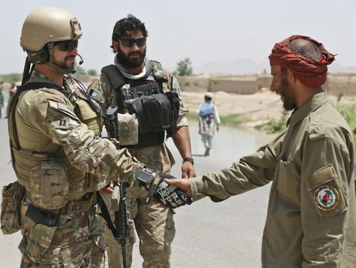 A U.S. Special Operations Forces team leader meets with a local Afghan Local Police checkpoint commander in Arghandab district, Kandahar province, Afghanistan, May 23, 2013. The SOF team conducted the visit to ALP checkpoints in the area to ensure their progress in providing security to the local villages by denying insurgents access to the local population. (U.S. Army photo by Staff Sgt. Kaily Brown/ Released)