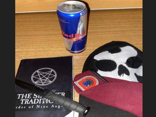 "Melzer's iCloud account allegedly included this image, which appears to depict a knife, a book entitled ""The Sinister Tradition: Order of Nine Angles,"" a skull mask, and a U.S. Army beret worn by paratroopers. (DoJ)"
