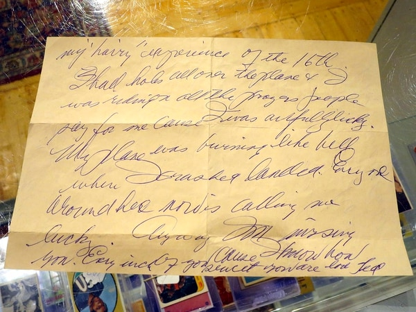 Part of a letter written by Boston Red Sox slugger Ted Williams the day after he crash-landed his airplane during the Korean War. Thirty-eight letters from Williams to his girlfriend at the time are going to be auctioned on Jan. 3. (David Sharp/AP)