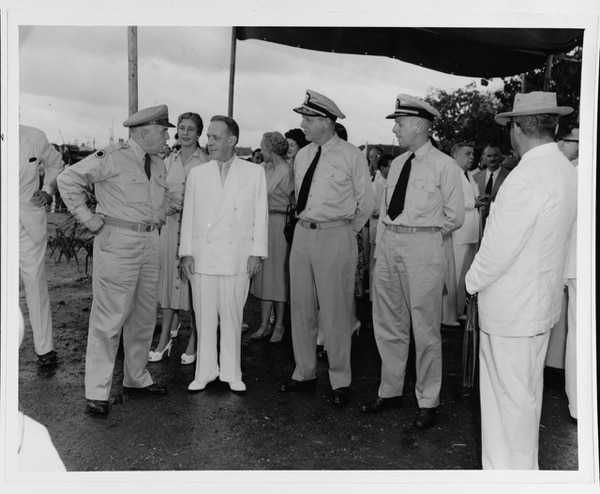 Lt. Gen. W. O'Daniel (Military Assistance Advisory Group Vietnam), Ambassador Donald R. Heath, Rear Adm. Aaron P. Storrs and other dignitaries await arrival of 100,000th refugee in Saigon from Haiphong during Operation