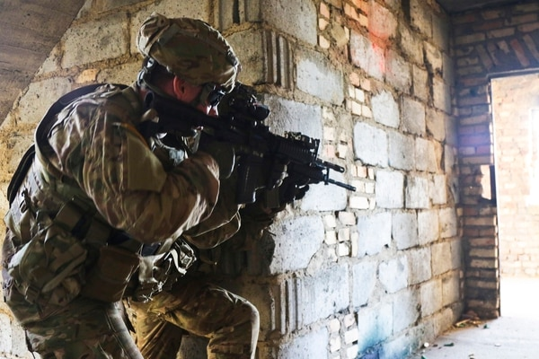 Paratroopers clear the floor of a building at an urban operations training center in Werdrzyn, Poland. The Army's updated field manual provides new guidance for war in large cities.