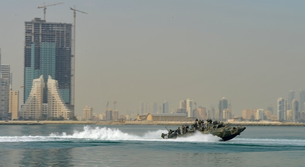 A riverine command boat skims the coastal waters of Bahrain in 2014. (Navy)