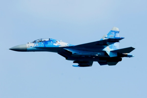 A Ukrainian Sukhoi Su-27 Flanker flies over the flightline during the opening ceremony of exercise Clear Sky at Starokostiantyniv air base, Ukraine. (Airman 1st Class Christopher Sparks/ Air Force)