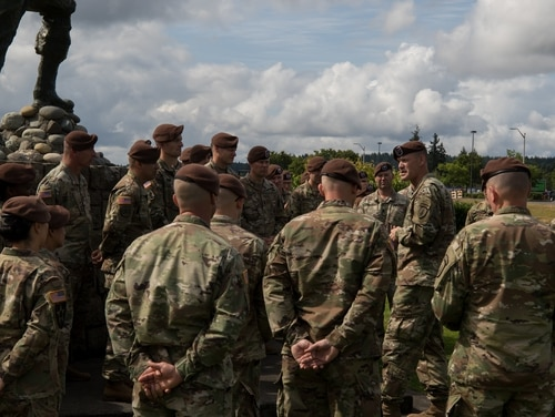 """Col. Curtis Taylor, commander of the 5th Security Force Assistance Brigade, addresses his troops following a beret donning ceremony in front of """"The Infantryman"""" memorial. (Spc. John Weaver/Army)"""