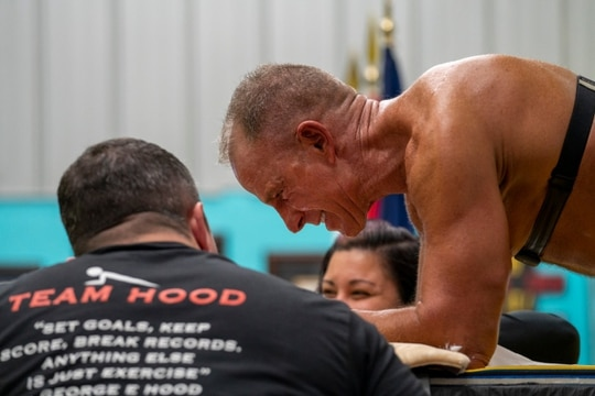Marine veteran, George Hood, smiles during his 8-hour planking attempt. Hood is a 12-time World Record holder. (Courtesy of George Hood/Josef Holic)