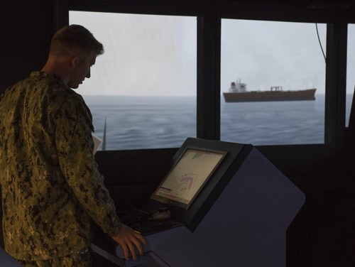 Then-Ensign Zachary David Hirsch participates in a navigation, seamanship and ship-handling trainer during a simulated evolution to evaluate officer of the deck proficiency last year. (Navy)