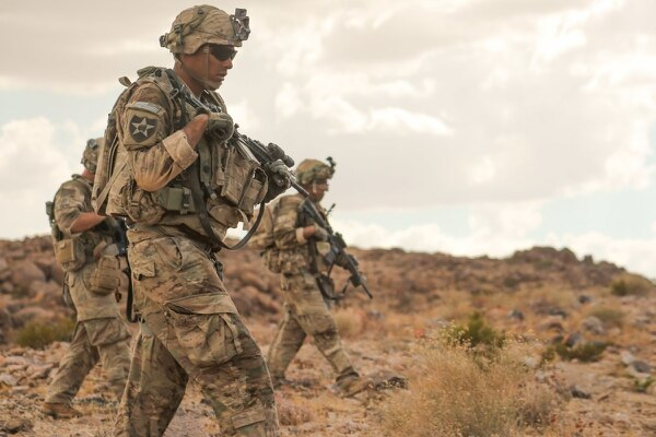 Soldiers from 2nd Brigade Combat Team, 1st Armored Division, patrol a hill top during a rotation at the National Training Center at Fort Irwin, Calif., Aug. 23, 2017. (Spc. Dana Clarke/Army)