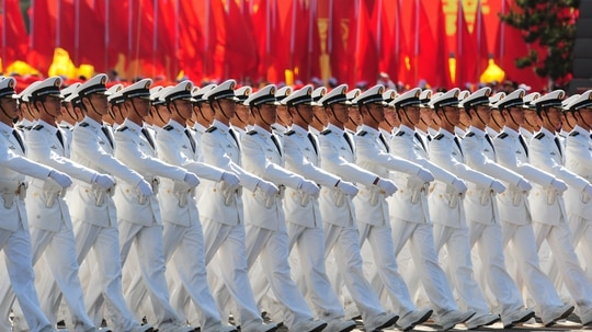 Chinese naval officers march pass Tiananmen Square during the National Day parade in Beijing on Oct. 1, 2009. (Frederic J. Brown/AFP)