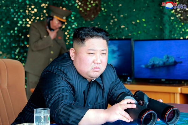 This Saturday, May 4, 2019, photo provided on Sunday, May 5, 2019, by the North Korean government shows North Korean leader Kim Jong Un observing tests of weapons systems. (Korean Central News Agency/Korea News Service via AP)