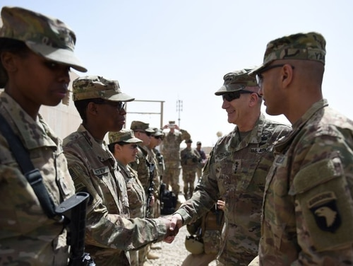 The US commander in Afghanistan Gen. John Nicholson, second fron right, shakes hands with US soldiers ahead of a handover ceremony at Leatherneck Camp in Lashkar Gah in the Afghan province of Helmand on April 29, 2017. (Wakil Kohsar/AFP via Getty Images)