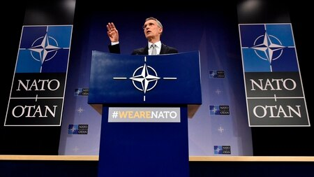 NATO Secretary General Jens Stoltenberg gestures as he delivers a speech to defense ministers at the NATO headquarters in Brussels on Feb. 15, 2018. (John Thys/AFP via Getty Images)