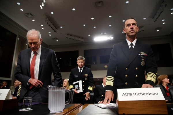 Secretary of the Navy Richard Spencer, left, and Chief of Naval Operations Adm. John Richardson, right, take their seats for a Senate Armed Services hearing on 'Recent United States Navy Incidents at Sea' Tuesday, Sept. 19, 2017, on Capitol Hill in Washington. (AP Photo/Jacquelyn Martin)