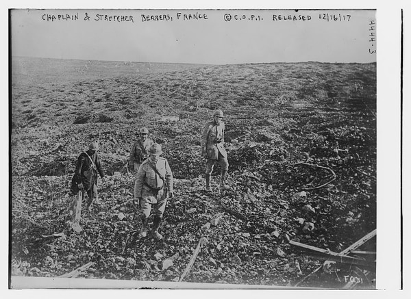 Regained Ground: Ground recovered near the River Meuse, near Beaumont, on Aug. 27, 1917. The picture shows a chaplain and stretcher bearer exploring