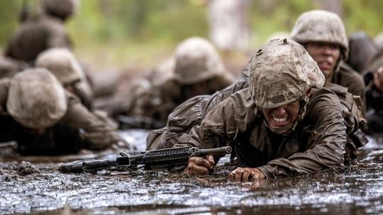 Marine Corps recruit Jorge Pelaez crawls through mud during the final challenge of recruit training, known as the Crucible, at Marine Corps Recruit Depot Parris Island, S.C., Oct. 13, 2017. (Lance Cpl. Devon Burton/Marine Corps)