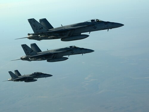 A formation of U.S. Navy F-18E Super Hornets leaves after receiving fuel from a KC-135 Stratotanker over northern Iraq. These aircraft were part of a large coalition strike package that was the first to strike ISIL targets in Syria. (Staff Sgt. Shawn Nickel/Air Force)
