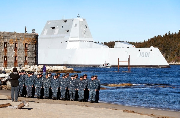 Sailors that are part of the crew of the future USS Michael Monsoor pose for a photo as the ship passes Fort Popham while heading out to sea for trials, Monday, Dec. 4, 2017, in Phippsburg, Maine. (Robert F. Bukaty/AP)