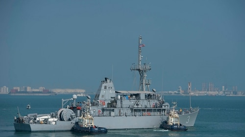 A sailor from the mine countermeasures ship Sentry, seen here getting underway in Bahrain, was killed April 5. (MC2 Martin L. Carey/Navy)