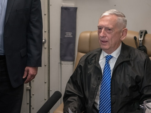 Defense Secretary James N. Mattis speaks to members of the press during a flight to Muscat, Oman, March 11, 2018. (Army Sgt. Amber I. Smith/DoD)