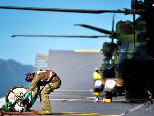 Refueling operations involving MRH90 and CH-53 helicopters were conducted during Exercise Sea Explorer on board the Royal Australian Navy flagship Canberra on June 9. (Staff Sgt. Daniel Wetzel/Marine Corps)