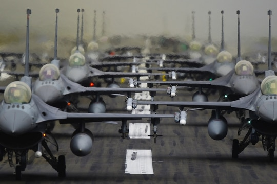 F-16 Fighting Falcons from the 52nd Fighter Wing line up in formation on the runway for a show-of-force display at Spangdahlem Air Base, Germany, Oct. 1. (Staff Sgt. Joshua R. M. Dewberry/Air Force)