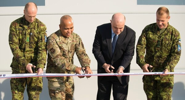 Air Force Brig. Gen. Roy Agustin, second from left, helps cut the ribbon on a new aircraft maintenance hangar with Lt. Col. Ülar Lohmus, commander of Amari Air Base, Estonian Minister of Defense Jüri Luik, and Col. Riivo Valge, Estonian air force chief, at Amari Air Base, Estonia. (Air Force)