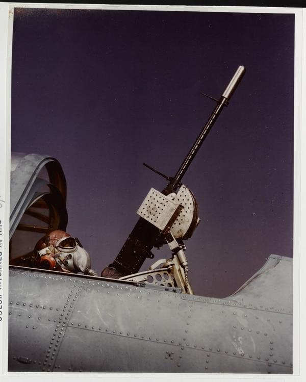 A Douglas SBD Dauntless aircraft gunner wearing oxygen mask, operates the flexible .30 caliber machine gun in the aft cockpit, circa 1941- 1943. (National Archives)