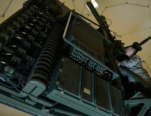 Tech. Sgt. Jonathan performs a visual inspection for corrosion prior to cleaning and lubricating the TPS-75 radar antenna at an undisclosed location in Southwest Asia, June 29, 2015. Sgt. Jonathan is a radar craftsman assigned to the Expeditionary Air Control Squadron. (U.S. Air Force photo/Tech. Sgt. Christopher Boitz)