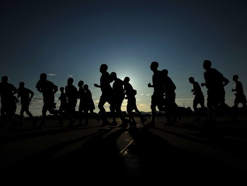 Airmen participate in a Warrior Run. (Staff Sgt. Rasheen A. Douglas/Air Force)