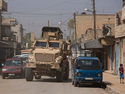 A U.S. armored vehicle drives through Tal Abyad, Syria, on a joint patrol with the Tax Abyad Military Council, an affiliate of the U.S.-backed Syrian Democratic Forces Friday, Sept. 6, 2019. (Maya Alleruzzo/AP)