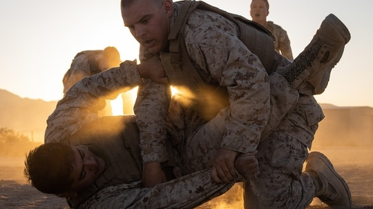 Cpl. Douglas Bunea, right, grapples with Cpl. Javier Flores while participating in a Marine Corps martial arts program course during Integrated Training Exercise (ITX) 5-19 at Marine Corps Air Ground Combat Center, Twentynine Palms, Calif., Aug. 15, 2019. (Cpl. Cody Rowe/Marine Corps)