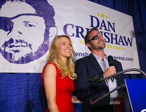 In this May 22, 2018, photo, Republican congressional candidate Dan Crenshaw reacts to the crowd with his wife, Tara, as he comes on stage to deliver a victory speech during an election night party at the Cadillac Bar, in Houston. (Mark Mulligan/Houston Chronicle via AP)