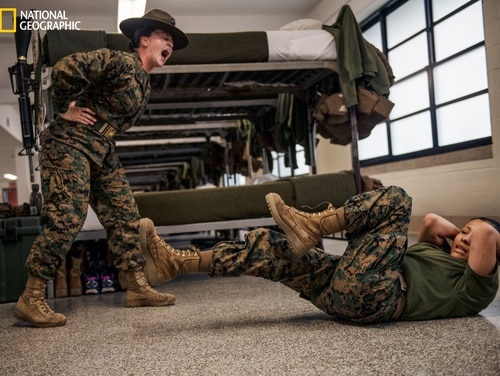 Staff Sgt. Hollie Mulvihill, 26, a Parris Island drill instructor, barks disciplinary consequences at recruit Melissa Rodriguez Flores, 18. (Lynsey Addario/National Geographic)