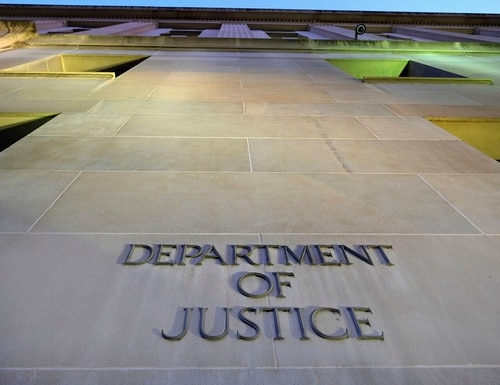 The Department of Justice wants companies to report data breaches. (J. David Ake/AP)