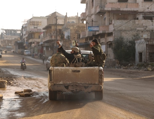 Syrian rebel drive toward the government positions near the village of Nerab, in Idlib province, Thursday, Feb. 6, 2020. (Ghaith Alsayed/AP)